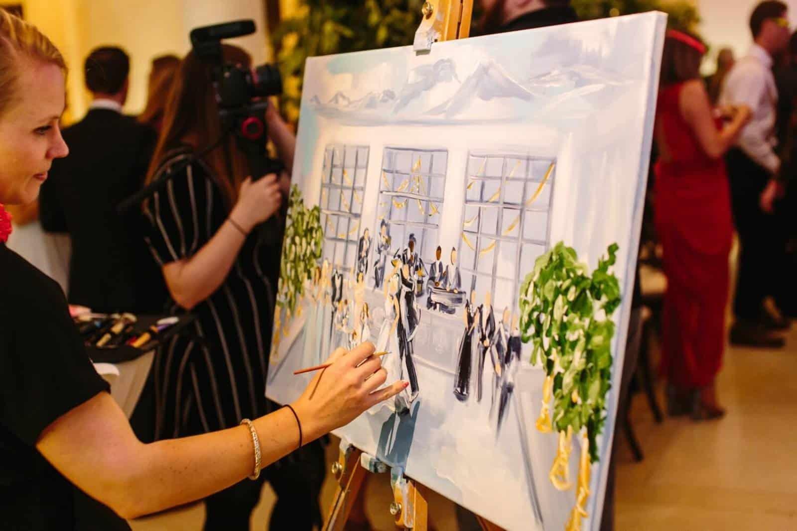 Frau malt bei der Hochzeit