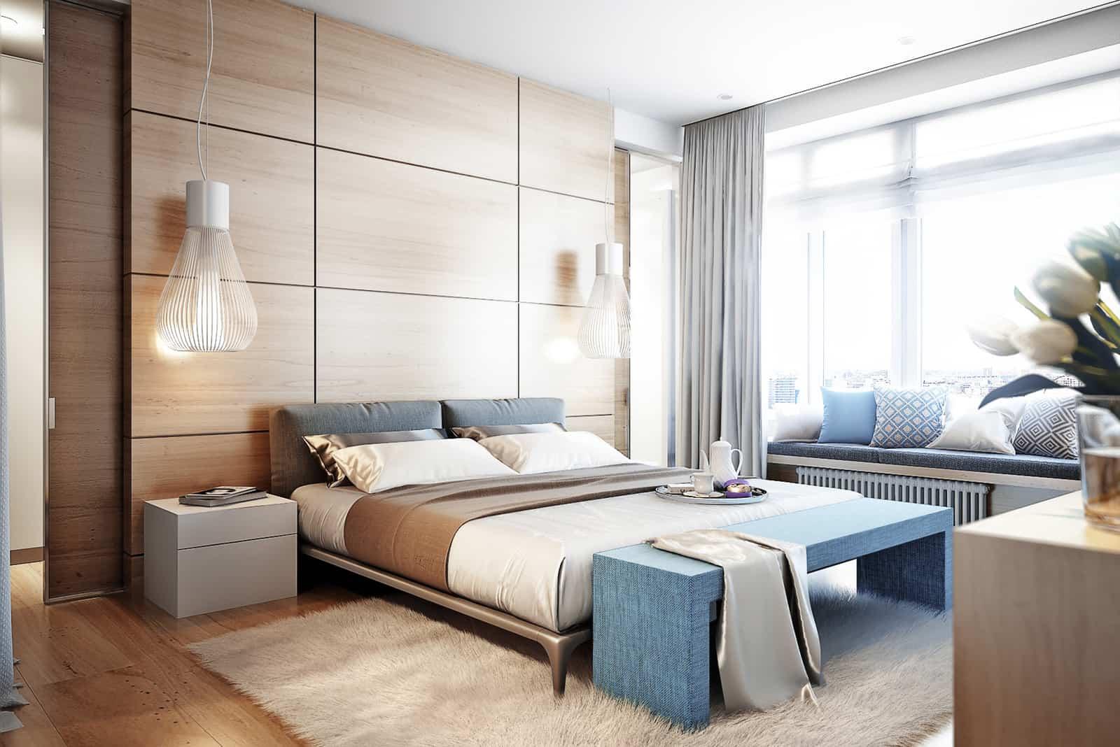 Helles und gemütliches modernes Schlafzimmer mit Ankleideraum